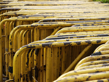 barrier: Yellow old steel barrier Stock Photo