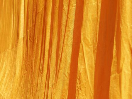 monk robe: crumpled yellow monk robe. Background