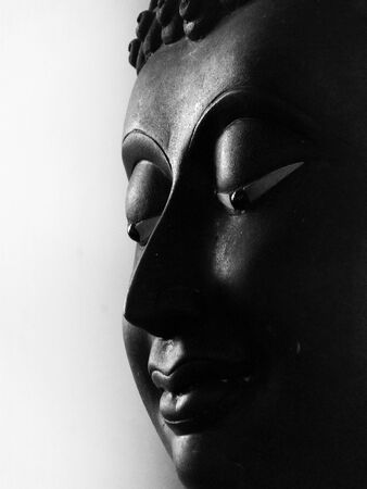 old Buddha face black and white Stock Photo