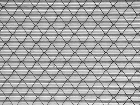 wire mesh: Wire Mesh and silver corrugated fence background