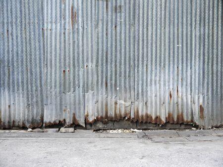 plat: Old damage rusty zinc plat wall with floor street Stock Photo