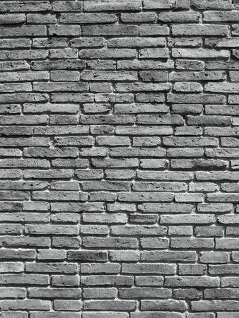 Grijze vuile bakstenen muur
