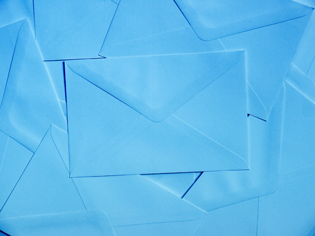 writing implements: Stack of blue envelops