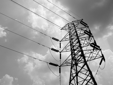 insulators: Silhouette of high voltage power lines Stock Photo