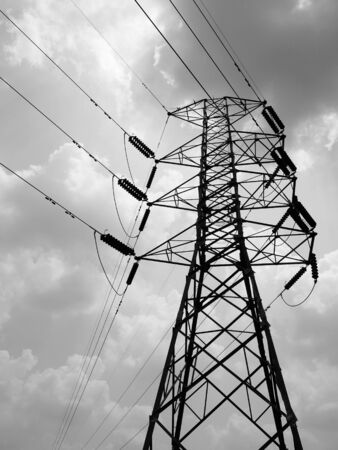 Silhouette of high voltage power lines Stock Photo