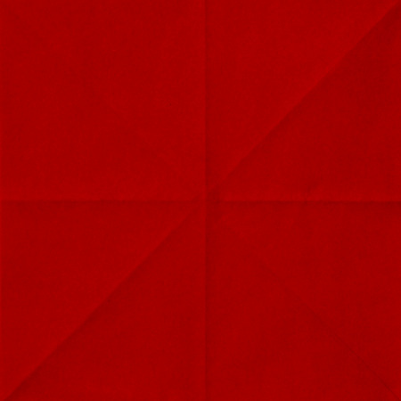 red sheet of paper folded texture Stock Photo