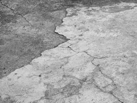 fissure: Cracked concrete texture closeup background