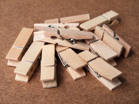 consolidate: Wooden clothespins on wood table