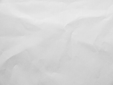 Crumpled white paper background Standard-Bild