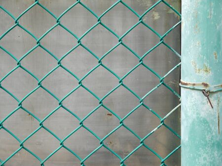 chained link fence: metal fence with mesh