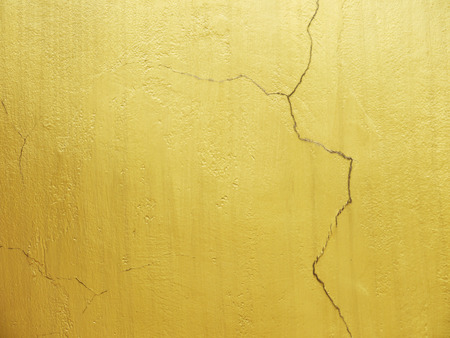 crack: golden wall with crack texture