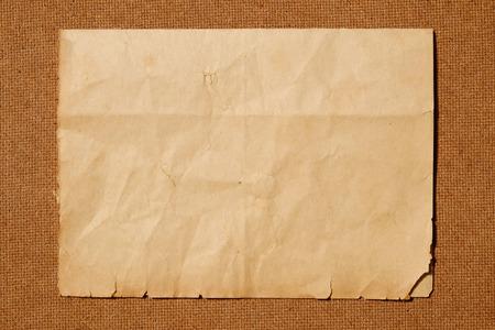 plywood: old paper on brown wood
