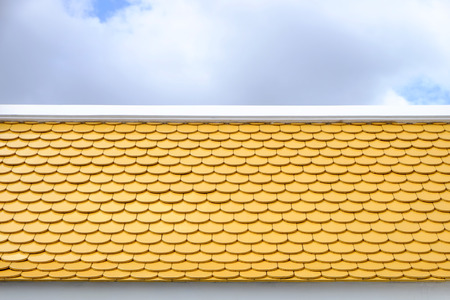 yellow roof with blue sky Stock Photo