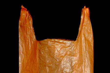 orange plastic bag on black background