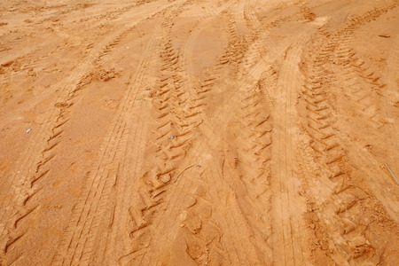 tire tracks: Tire tracks on the sand Stock Photo
