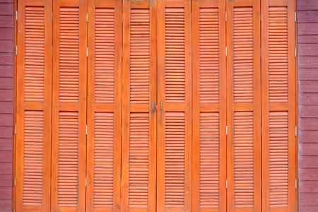 deteriorate: The Thai style vintage wooden door Stock Photo