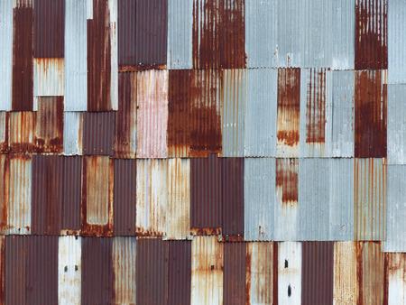 galvanized: Rusty corrugated metal wall