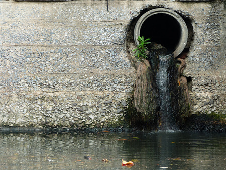 drain water: Drain water - allow to drain into the canal Stock Photo