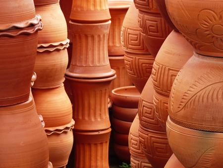 terracotta: Piles of terracotta pots in a store