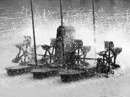 fill in: Aerator turbine wheel fill oxygen into water in lake Stock Photo