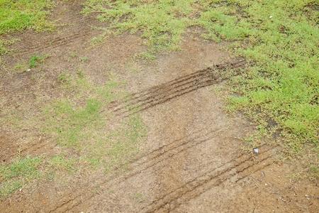 muddy: Muddy tire track on the grass way Stock Photo