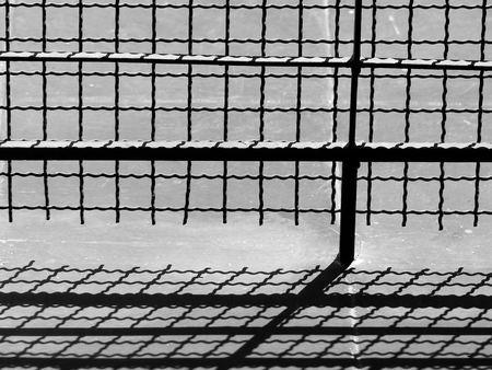 depress: Light and shadow on the cage floor Stock Photo