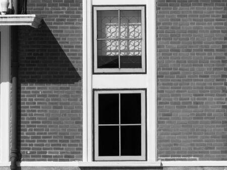 rusty nail: black and white window on brick wall