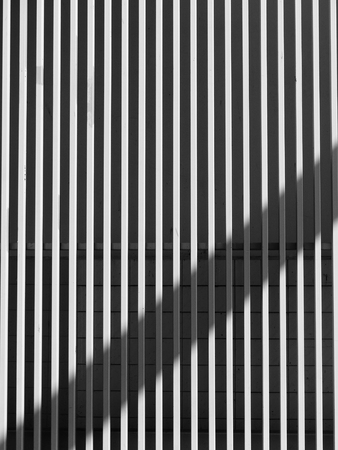 building sector: black and white architecture metal wall design with light and shadow