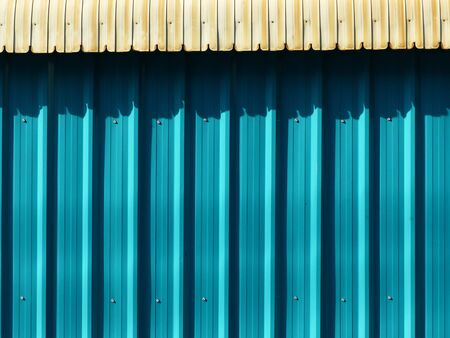Blue color corrugated metal sheet street wall Stock Photo
