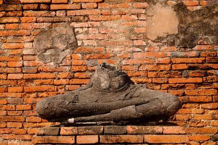 old brick wall: old ancient buddha in Wat Chaiwatthanaram temple,Ayutthaya Historical Park, Thailand