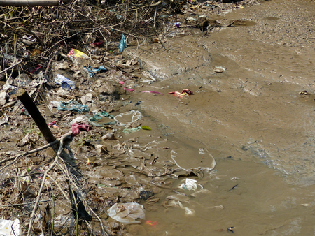 garbage on mud in the ground