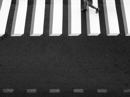 black and white zebra crossing in city