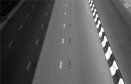 asphalt road texture with white dashed line