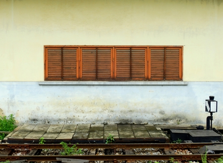 age street wall with railroad track Stock Photo