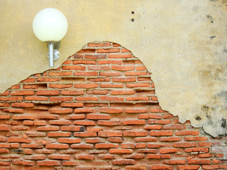 cracked concrete vintage brick wall with lamp background