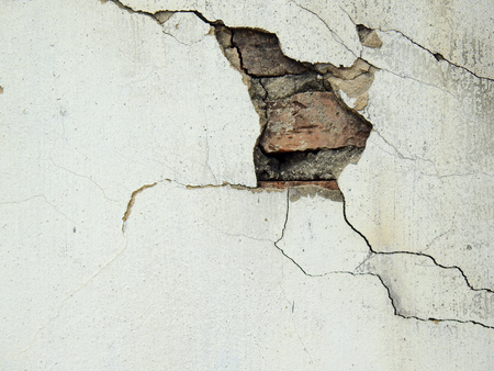 old white wall with crack