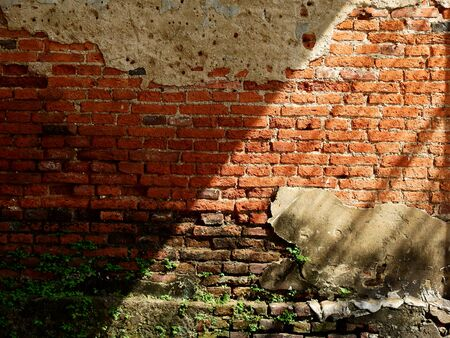 aged street damage brick wall with light and shadow