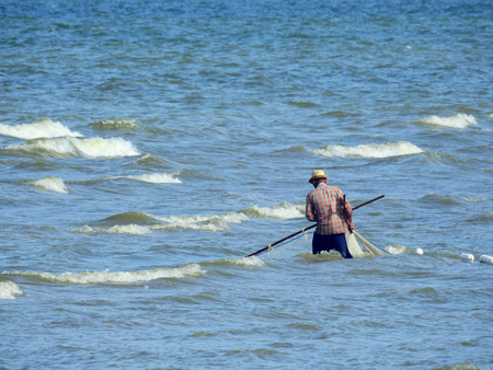 Fishermen drag the nets in the sea