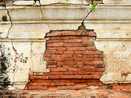 Cracks in the ancient brick wall in the archaeological site Stock Photo