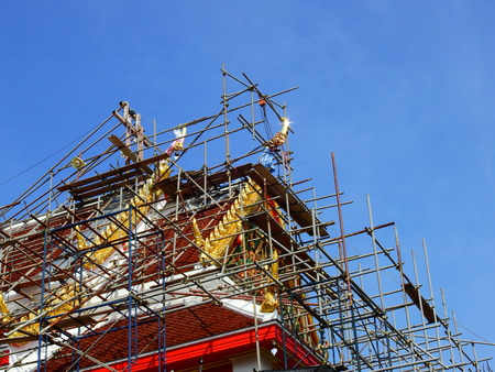 repair old temple of Thailand with blue sky