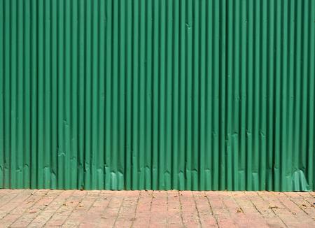 green zinc wall with street floor