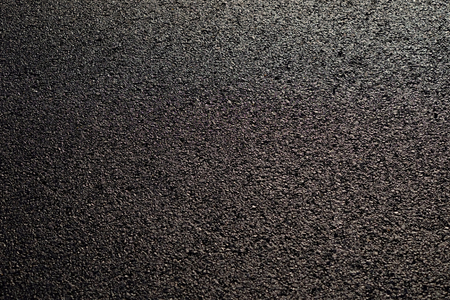 wet asphalt road with sunny texture