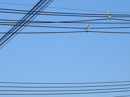 silhouette electric wire on blue sky background