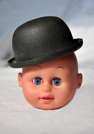 wierd: Doll head with hat