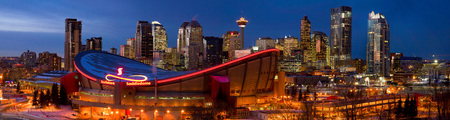 Downtown Calgary Alberta with the Saddledome in the evening.