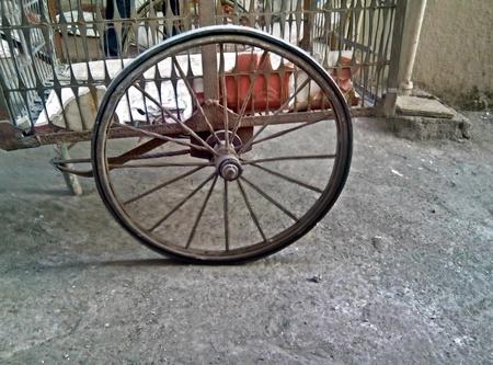 stood: The spoke wheel stood time Stock Photo