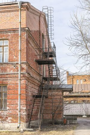 fire bricks: Old brick building with iron stairs Stock Photo
