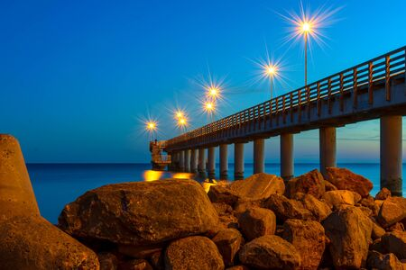 Pier with night lighting in the town of Zelenogradsk on the coast of the Baltic sea