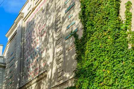 measures: RUSSIA, SAINT-PETERSBURG - SEPTEMBER, 2016: the periodic system of chemical elements D. I. Mendeleev on the wall of the chamber of weights and measures