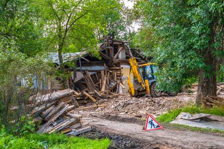 volkhov: RUSSIA, LENINGRAD REGION, VOLKHOV-1 — August, 2016: Demolition of old wooden buildings in the centre of the city of Volkhov-1 in the Leningrad region